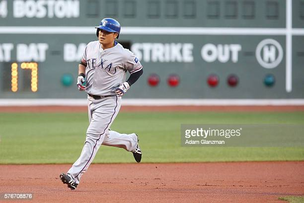 Shin Soo Choo of the Texas Rangers rounds the bases after hitting a home run in the first inning during the game against the Boston Red Sox at Fenway...