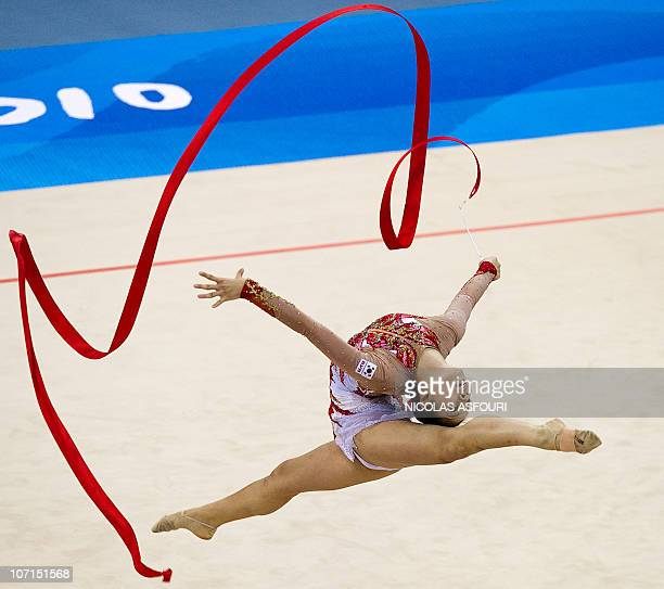 Shin Soo Ji of South Korea performs during the rhythmic gymnastics individual allaround final during the 16th Asian Games on November 26 2010 Anna...