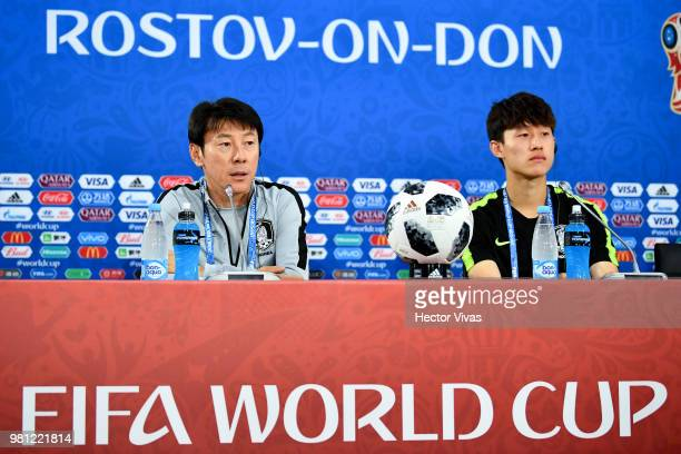 Shin TaeYong coach of South Korea and Lee JaeSung speak during a training and press conference ahead of the match against Mexico as part of FIFA...