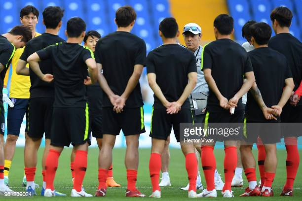 Shin TaeYong coach of South Korea talks to his players during a training and press conference ahead of the match against Mexico as part of FIFA World...