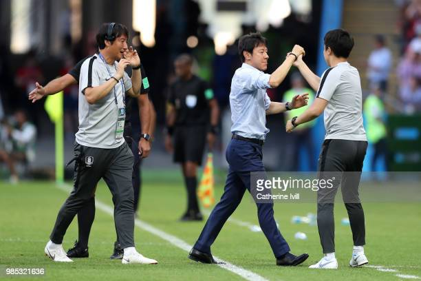 Shin TaeYong Manager of Korea Republic reacts with his backroom staff during the 2018 FIFA World Cup Russia group F match between Korea Republic and...