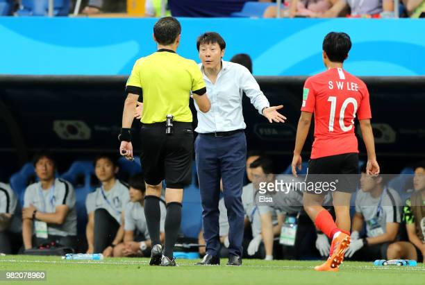Shin TaeYong Manager of Korea Republic speaks to the referee during the 2018 FIFA World Cup Russia group F match between Korea Republic and Mexico at...