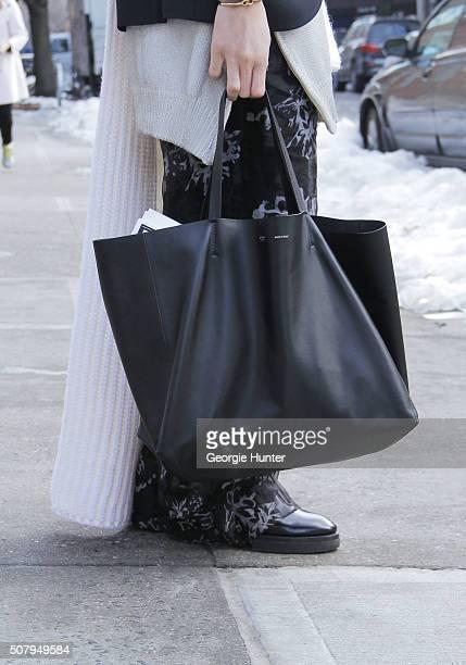 Shin Yamada seen at Industria Superstudios wearing Acne Studios heeled black boots JWAnderson black and white pants JWAnderson oversized white and...