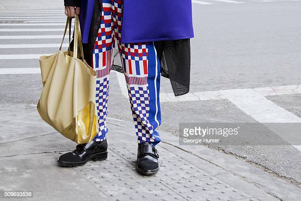 Shin Yamada seen at Skylight Clarkson Sq. Outside the Erin Fetherston show wearing Vivienne Westwood purple coat, checked Alexander McQueen pants,...