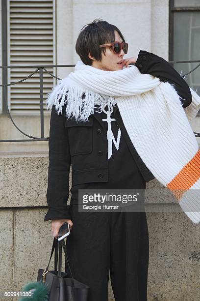 Shin Yamada seen at The Arc, Skylight at Moynihan Station outside the Concept Korea show wearing Commes Des Garcon coat, Cline black leather bag with...