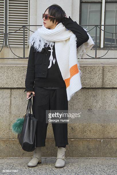 Shin Yamada seen at The Arc, Skylight at Moynihan Station outside the Concept Korea show wearing Commes Des Garcon coat, Chloe boots, Cline black...