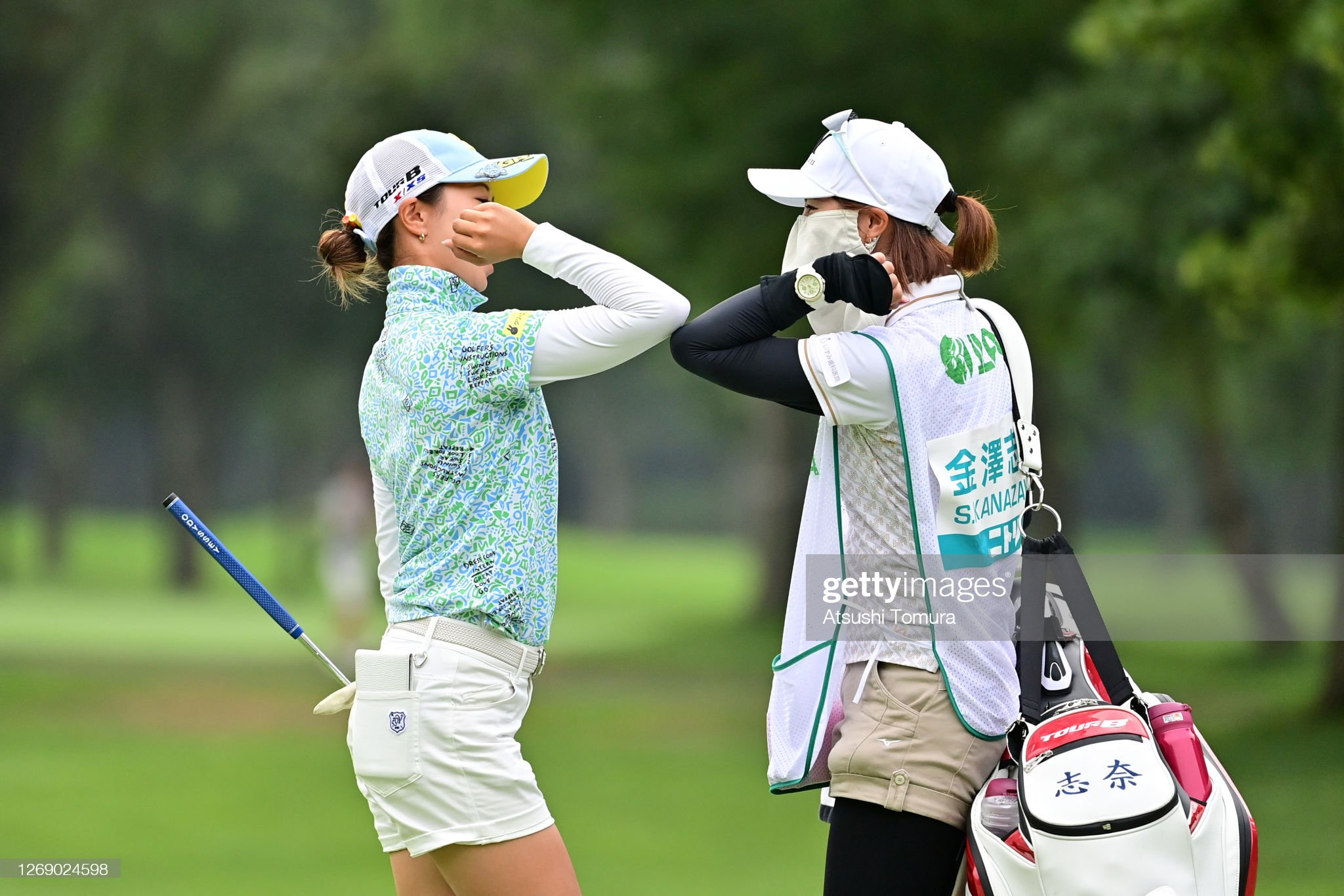 https://media.gettyimages.com/photos/shina-kanazawa-of-japan-elbow-bumps-with-her-caddie-after-the-birdie-picture-id1269024598?s=2048x2048