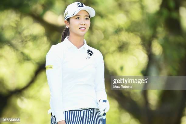 Shina Kanazawa of Japan watches her tee shot on the 12th hole during the first round of the Hoken No Madoguchi Ladies at the Fukuoka Country Club on...