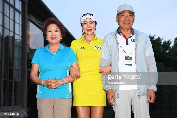 ShinAe Ahn and her parents of South Korea poses during the first round of the Earth Mondamin Cup at the Camellia Hills Country Club on June 22 2017...