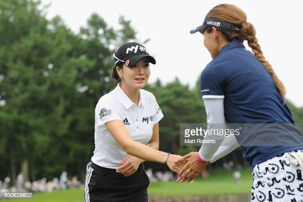 ShinAe Ahn of South Korea and Hikari Fujita of Japan shake hands on the 18th green during the second round of the NEC Karuizawa 72 Golf Tournament...