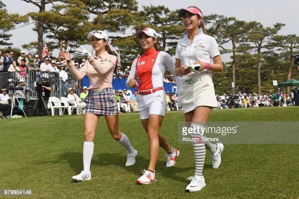 ShinAe Ahn of South Korea BoMee Lee of South Korea and Kumiko Kaneda of Japan walk the 1st fairway during the final round of the World Ladies...