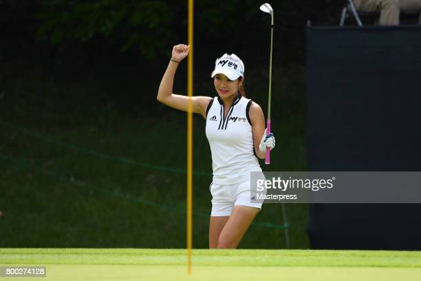 ShinAe Ahn of South Korea reacts after chipping in for the birdie on the 16th green during the third round of the Earth Mondamin Cup at the Camellia...