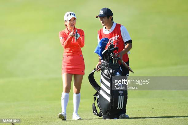 ShinAe Ahn of South Korea talks to her caddie during the first round of the Higuchi Hisako Ponta Ladies at the Musashigaoka Golf Course on October 27...