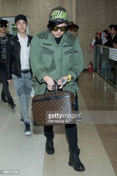 Shindong of boy band Super Junior M is seen upon arrival at the Gimpo Airport on October 28, 2013 in Seoul, South Korea.