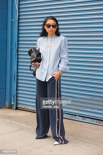 Shine By Three Blogger and Matches Fashion SS15 Guest Buyer Margaret Zhang exits Karen Walker on Day 5 of New York Fashion Week Spring/Summer 2015 on...