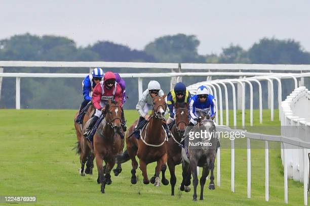 Shine So Bright with S De Sousa and Safe Voyage with jockey Jason Hart lead the Investec Surrey Stakes on Epsom Downs south of London on July 4 2020...