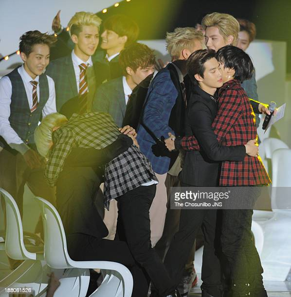 SHINee and EXO onstage during the 2013 Melon Music Awards at Olympic Gymnastics Stadium on November 14 2013 in Seoul South Korea
