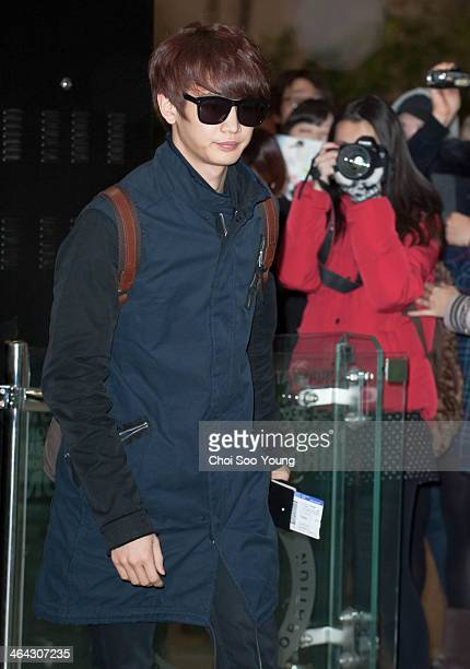 SHINee is seen at Gimpo International Airport on January 18 2014 in Seoul South Korea