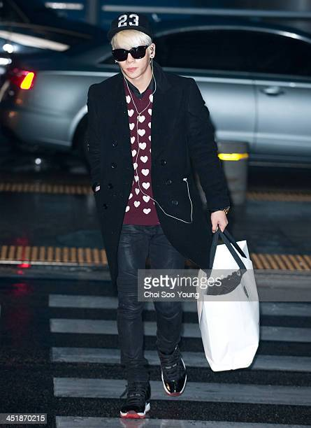 SHINee is seen at Incheon International Airport on November 24 2013 in Incheon South Korea