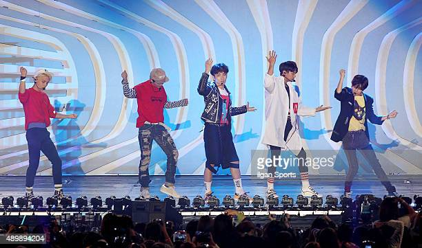 SHINee perform onstage during the 2015 Hallyu Dream Festival at Gyeongju Civic Stadium on September 20 2015 in Gyeongju South Korea