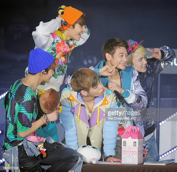 SHINee perform onstage during their 'Dream Girl' Comeback Showcase at Olympic Park Handball Stadium on February 20 2013 in Seoul South Korea