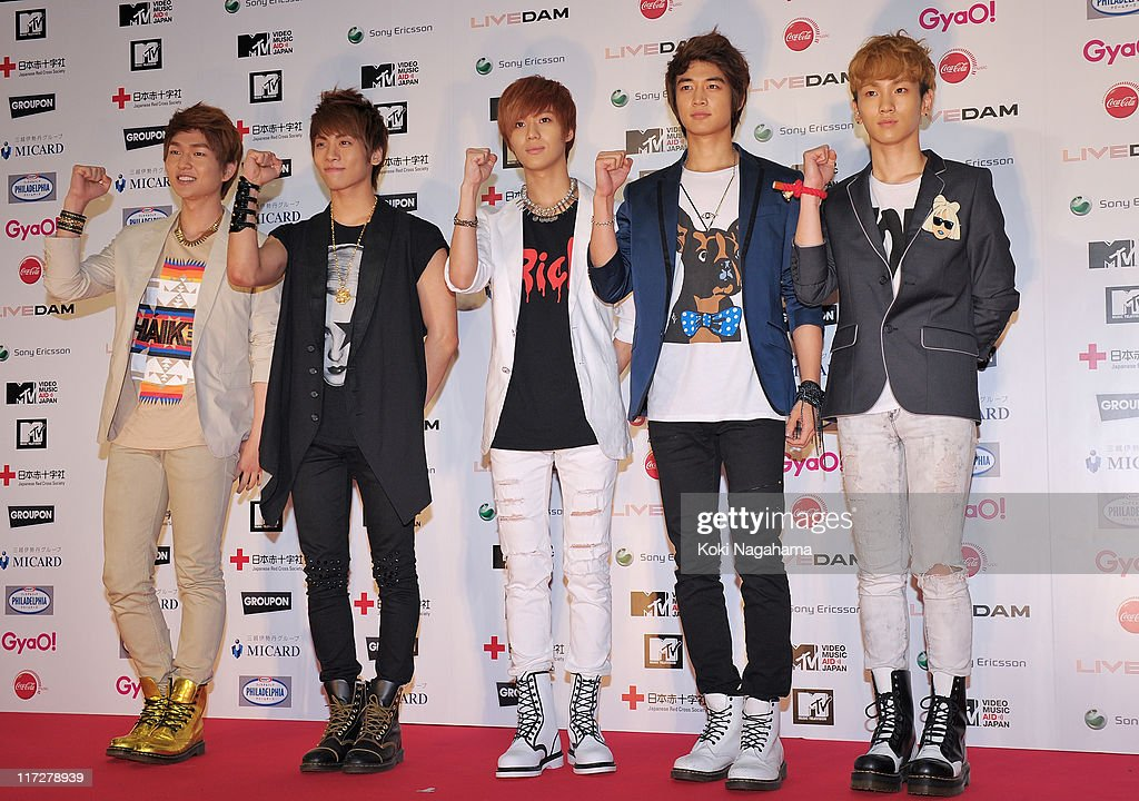 SHINee walk on the red carpet during the MTV Video Music Aid Japan on June 25, 2011 in Chiba, Japan.