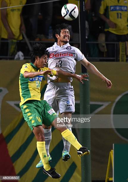 Shingo Arizono of Thespa and Yamato Machida of JEF United compete for the ball during the JLeague second division match between JEF United Chiba and...