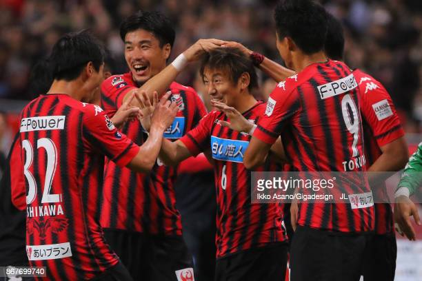 Shingo Hyodo of Consadole Sapporo celebrates scoring his side's first goal with his team mates during the JLeague J1 match between Consadole Sapporo...
