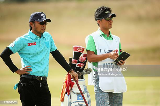 Shingo Katayama of Japan and his caddie Yoshi Sato look on during the first round of the 142nd Open Championship at Muirfield on July 18 2013 in...