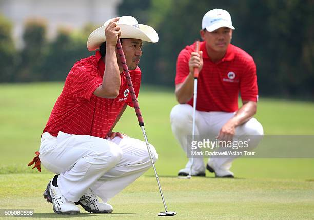 Shingo Katayama of Japan and Wu Ashun of China attempt to read the green on 16 green during day one of the EurAsia Cup presented by DRBHICOMat...