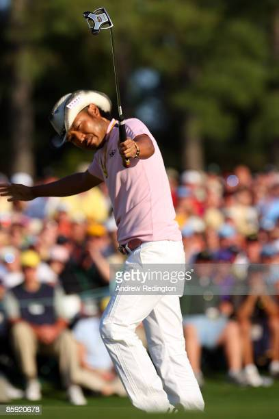 Shingo Katayama of Japan celebrates a birdie putt on the 18th green during the final round of the 2009 Masters Tournament at Augusta National Golf...