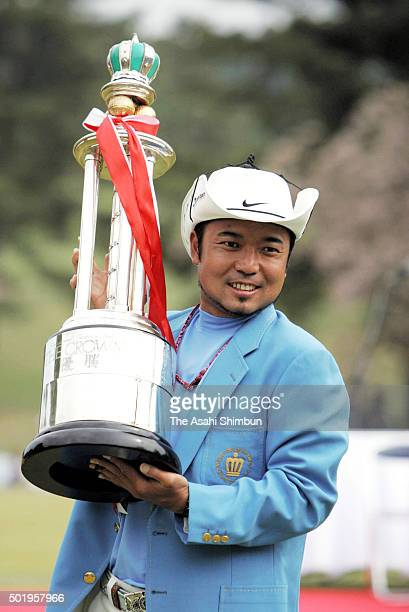 Shingo Katayama of Japan celebrates with the rophy after winning the Crowns at the Nagoya Golf Club Wago Course on April 1, 2006 in Togo, Aichi,...