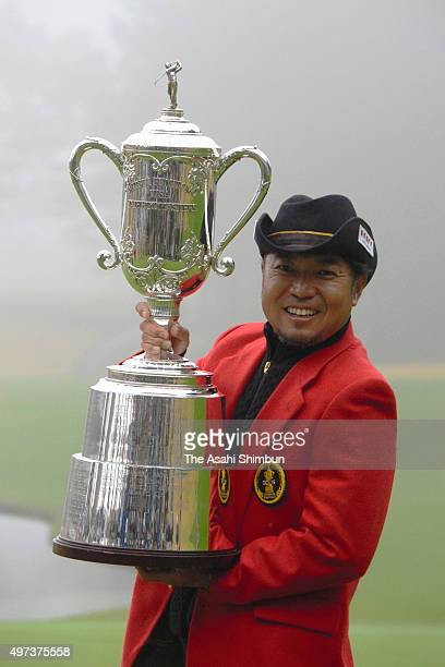 Shingo Katayama of Japan celebrates with the trophy after winning the Mitsui Sumitomo VISA Taiheiyo Masters at Taiheiyo Club Gotemba Course on...