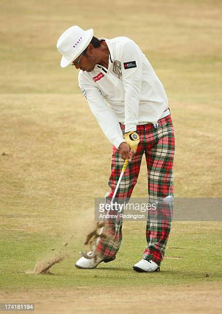 Shingo Katayama of Japan hits an approach shot on the 1st hole during the final round of the 142nd Open Championship at Muirfield on July 21 2013 in...