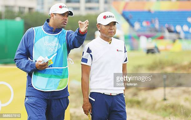 Shingo Katayama of Japan lines up his tee shot on the eighth hole with his caddie Rajiv Prasad during the second round of the golf on Day 7 of the...