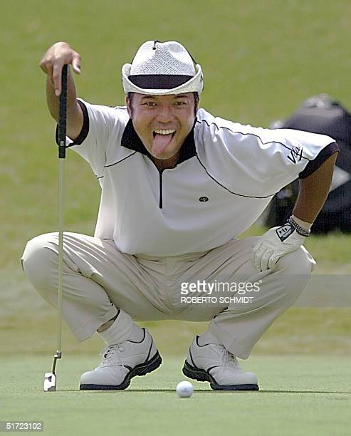 Shingo Katayama of Japan sticks out his tongue on the ninth hole 17 August 2001 during the second round of the 83rd PGA Championship at the Atlanta...