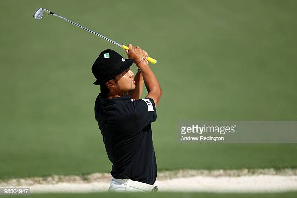 Shingo Katayama of Japan watches a shot during a practice round prior to the 2010 Masters Tournament at Augusta National Golf Club on April 7, 2010...