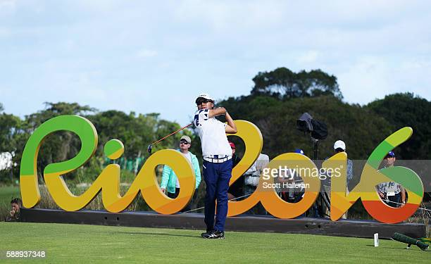 Shingo Katayama of Japan watches his tee shot on the 16th hole during the second round of the golf on Day 7 of the Rio 2016 Olympic Games at the...