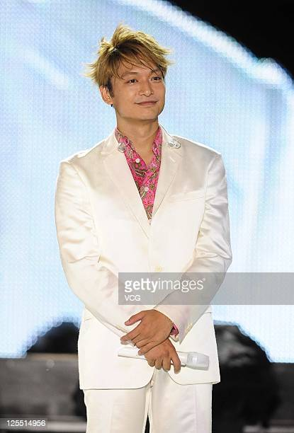 Shingo Katori of Japanese boy band SMAP performs on the stage at Beijing Concert at Beijing Workers Stadium on September 16 2011 in Bejing China