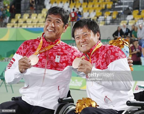 Shingo Kunieda and Satoshi Saida of Japan celebrate winning the bronze medal in the men's wheelchair tennis doubles at the Rio de Janeiro Paralympics...