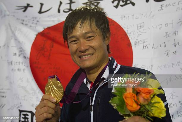 Shingo Kunieda celebrates with his Gold Medal after the Mens Wheelchair Gold Medal match on day 10 of the London 2012 Paralympic Games at Eton Manor...