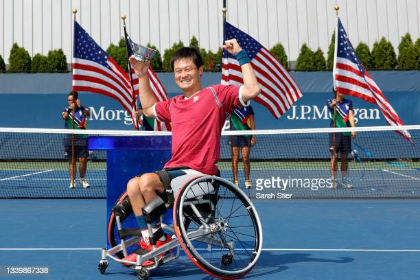 Shingo Kunieda of Japan celebrates with the championship trophy after defeating Alfie Hewett of Great Britain during his Wheelchair Men's Singles...