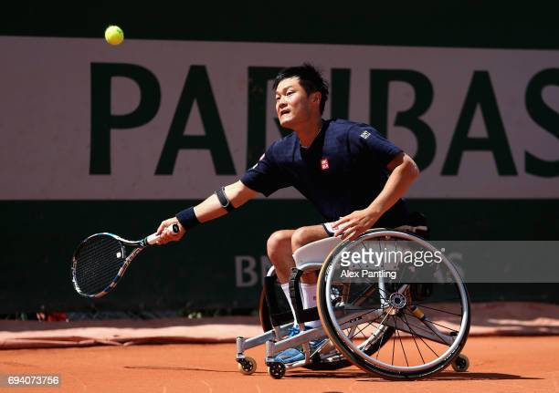 Shingo Kunieda of Japan plays a forehand during mens wheelchair singles semi-final match against Alfie Hewett of Great Britain on day thirteen of the...