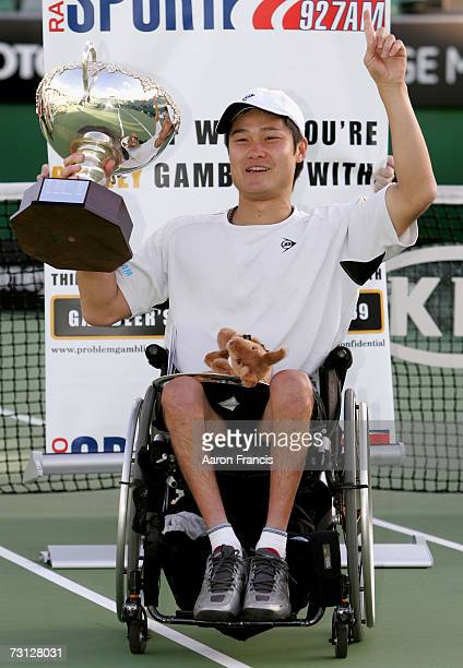 Shingo Kunieda of Japan poses with his trophy after winning his wheelchair final match against Michael Jeremiasz of France on day thirteen of the...