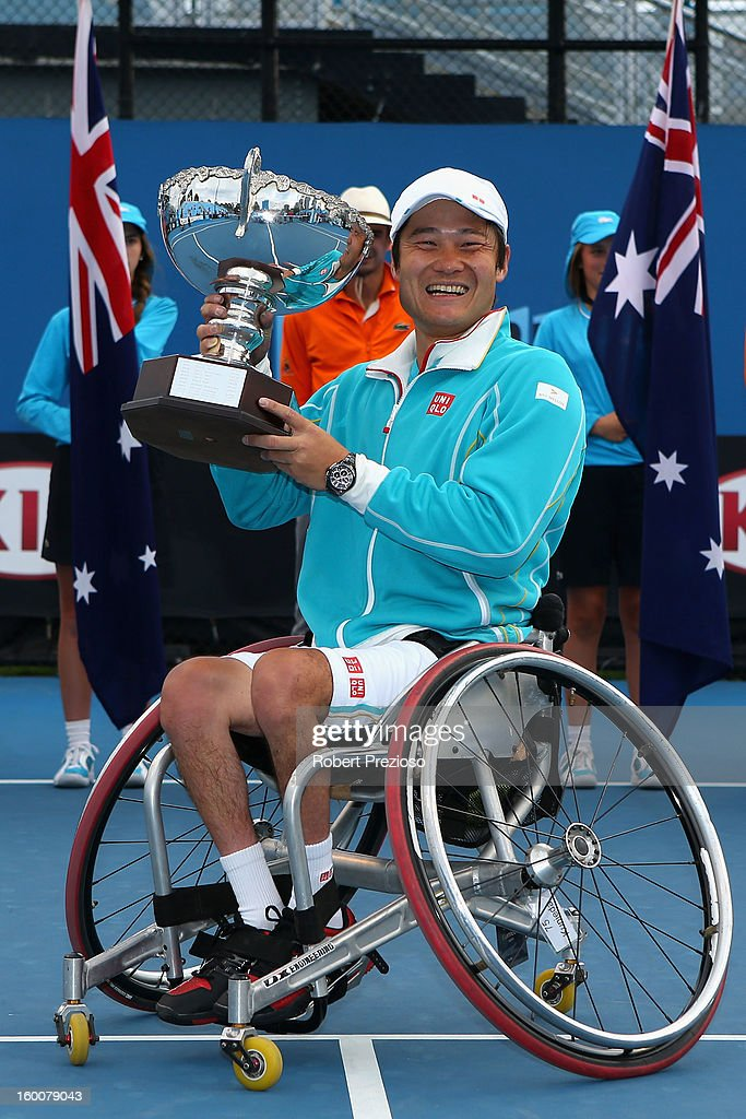 Shingo Kunieda of Japan poses with the championship trophy after winning his Men's Wheelchair Singles Final match against Stephane Houdet of France during the 2013 Australian Open Wheelchair Championships at Melbourne Park on January 26, 2013 in Melbourne, Australia.
