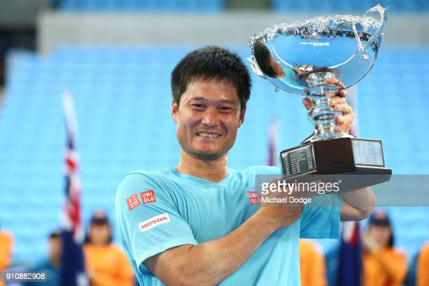 Shingo Kunieda of Japan poses with the championship trophy after winning the Men's Wheelchair Singles Final against Stephane Houdet of France during...