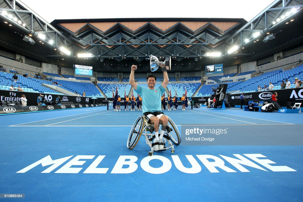 Shingo Kunieda of Japan poses with the championship trophy after winning the Men's Wheelchair Singles Final against Stephane Houdet of France during the Australian Open 2018 Wheelchair Championships at Melbourne Park on January 27, 2018 in Melbourne, Australia.