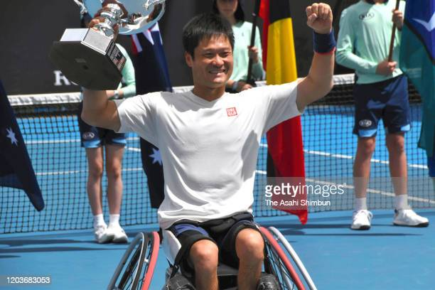 Shingo Kunieda of Japan poses with the trophy after his victory in the Men's Wheelchair Singles Final against Gordon Reid of Great Britain on day...