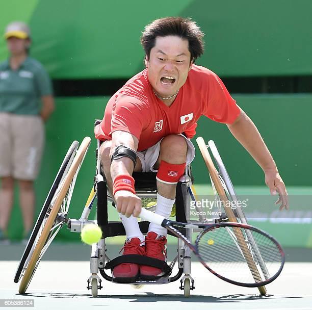 Shingo Kunieda of Japan returns a shot against Joachim Gerard of Belgium during the men's wheelchair tennis singles quarterfinals at the Rio de...