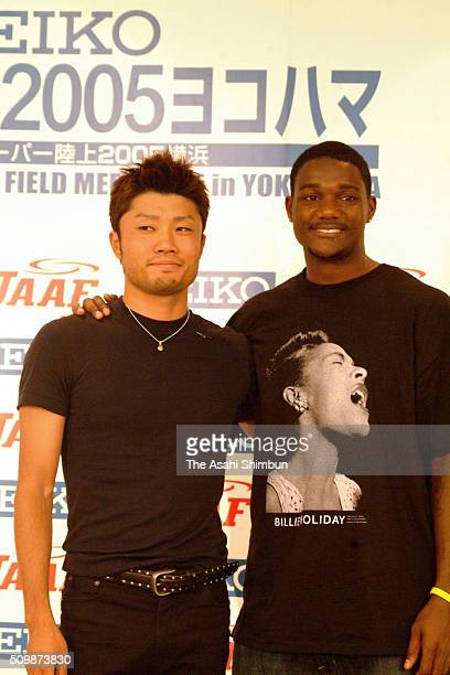 Shingo Suetsugu of Japan and Justin Gatlin of the United States pose for photographs during the Seiko Super Track And Field Meet 2005 In Yokohama...